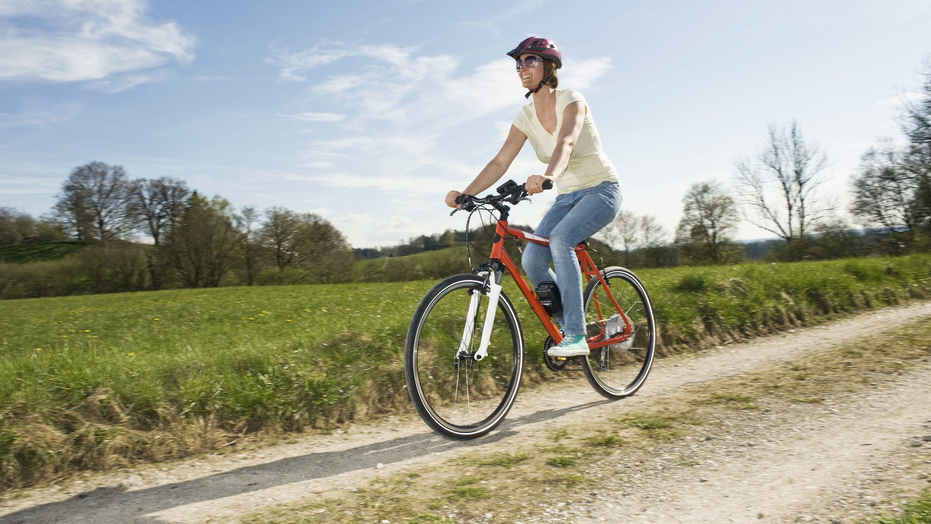 woman on ebike riding trail