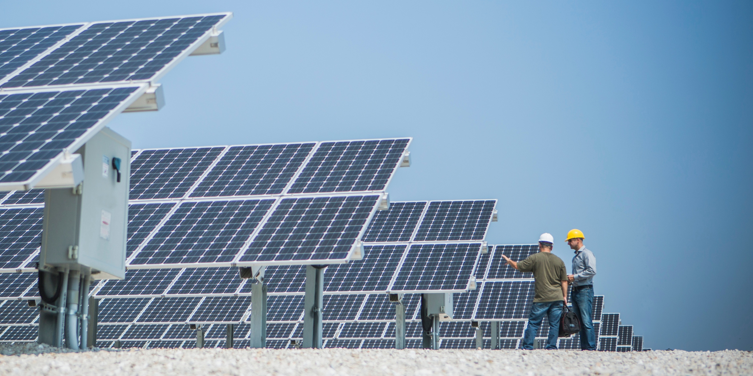 technicians near solar panels