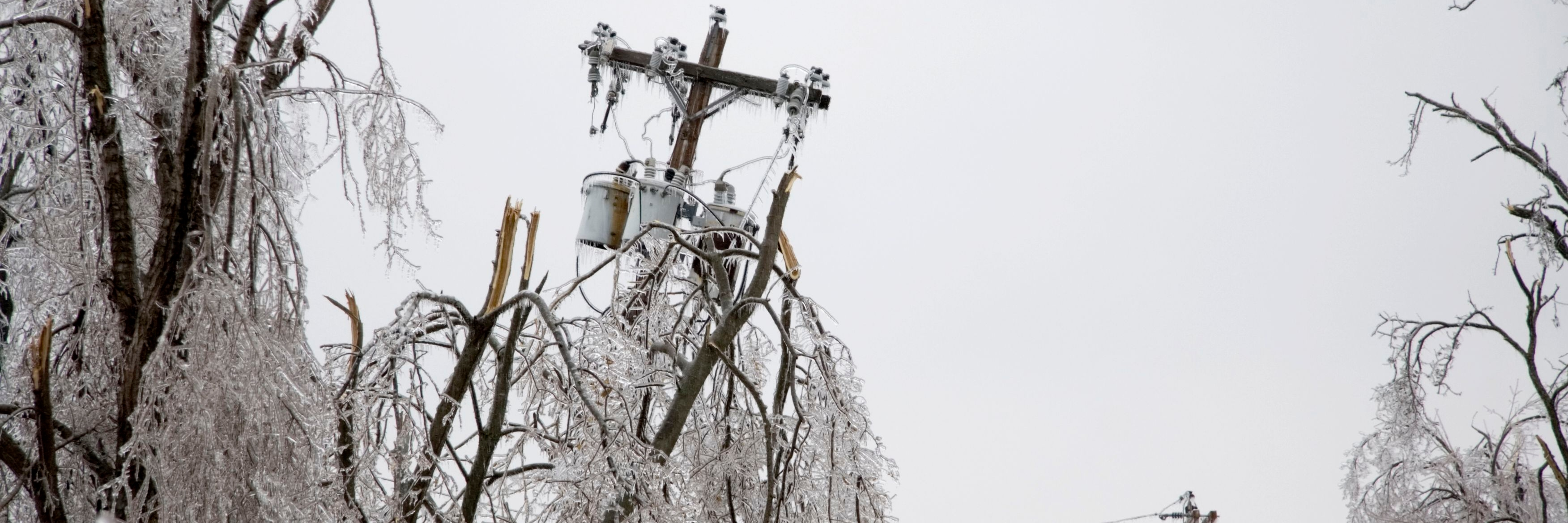 Power pole falling after blizzard