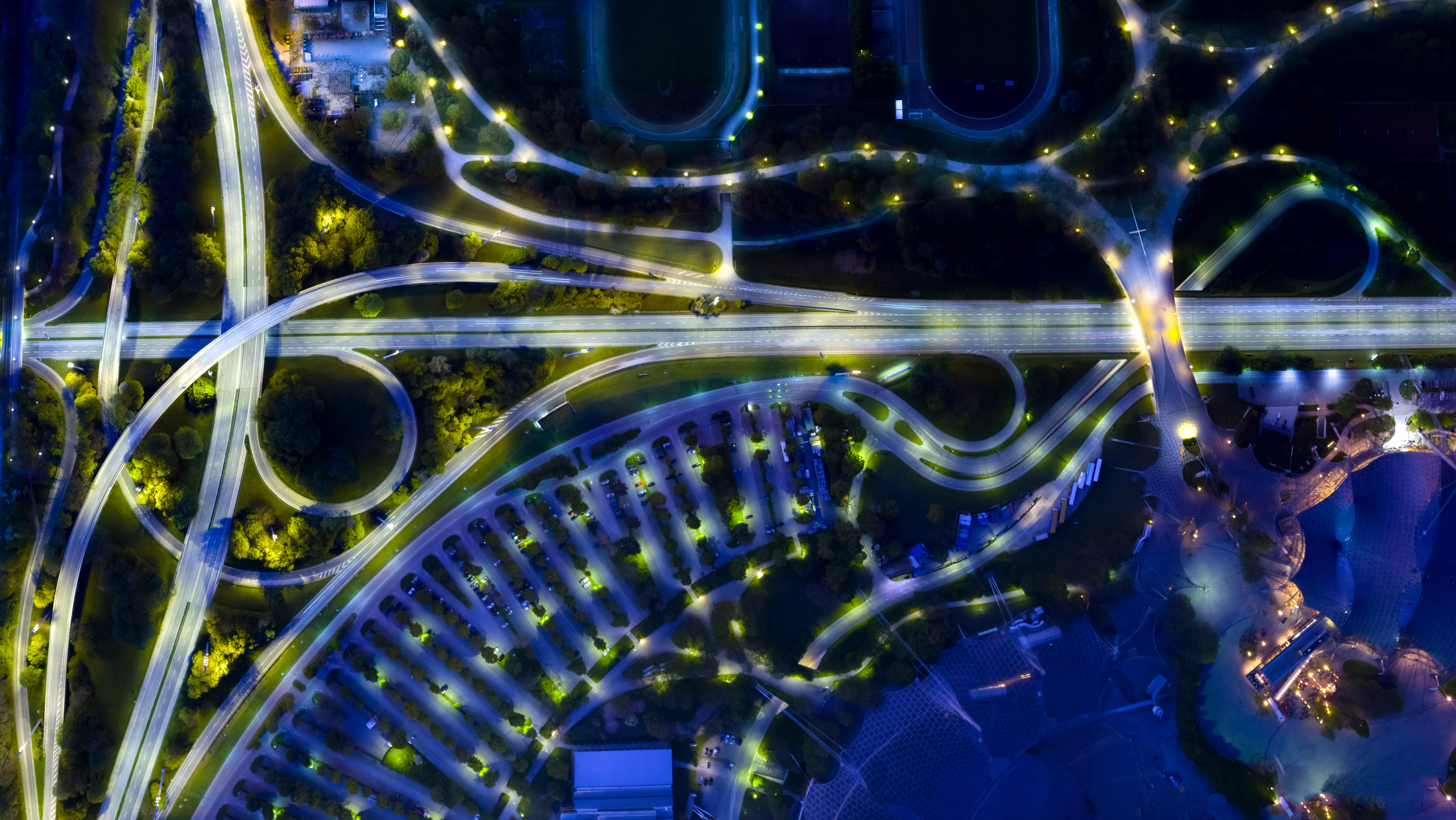aerial shot of a town and highway