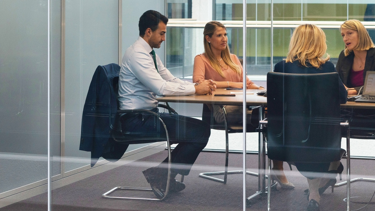 employees in meeting room