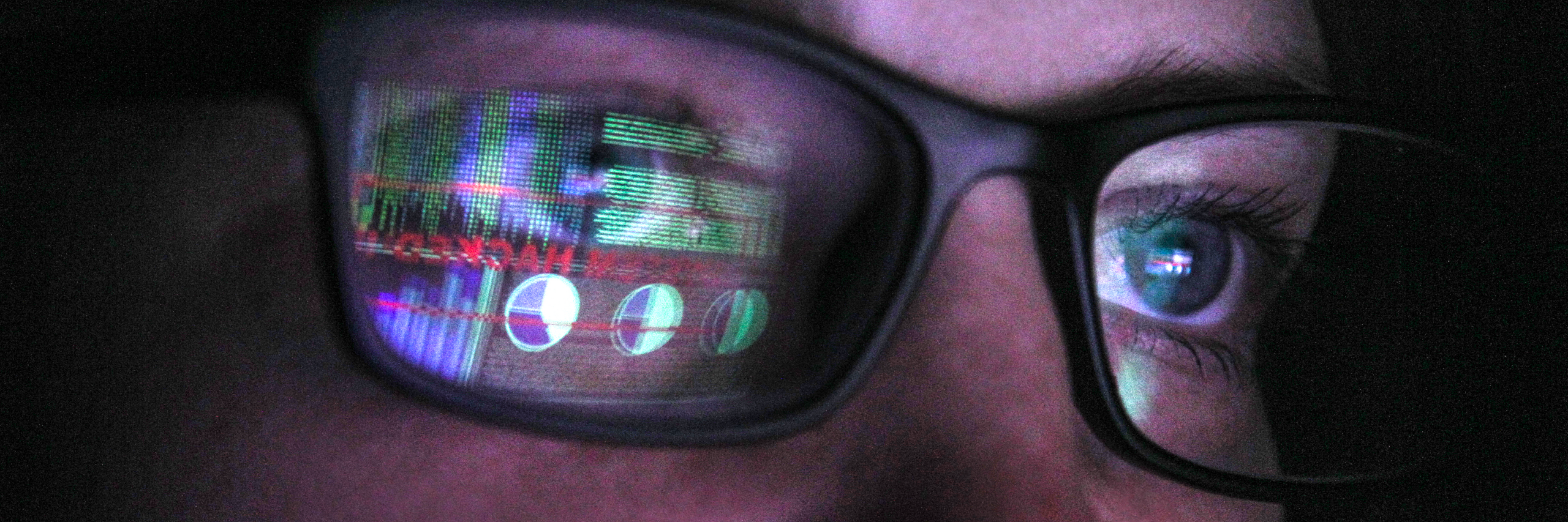 Woman with eye glasses with a computer reflection of data and cyber