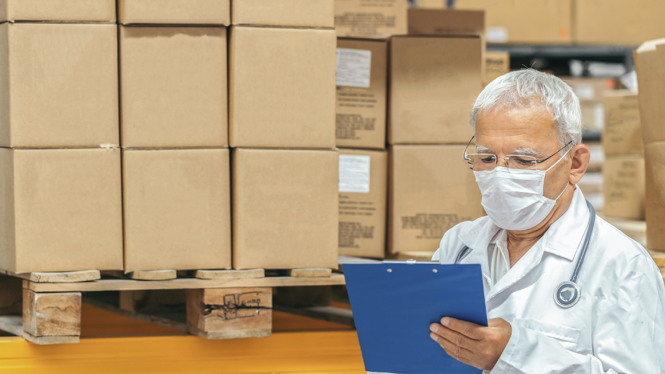 Doctor checking medical supplies in a warehouse