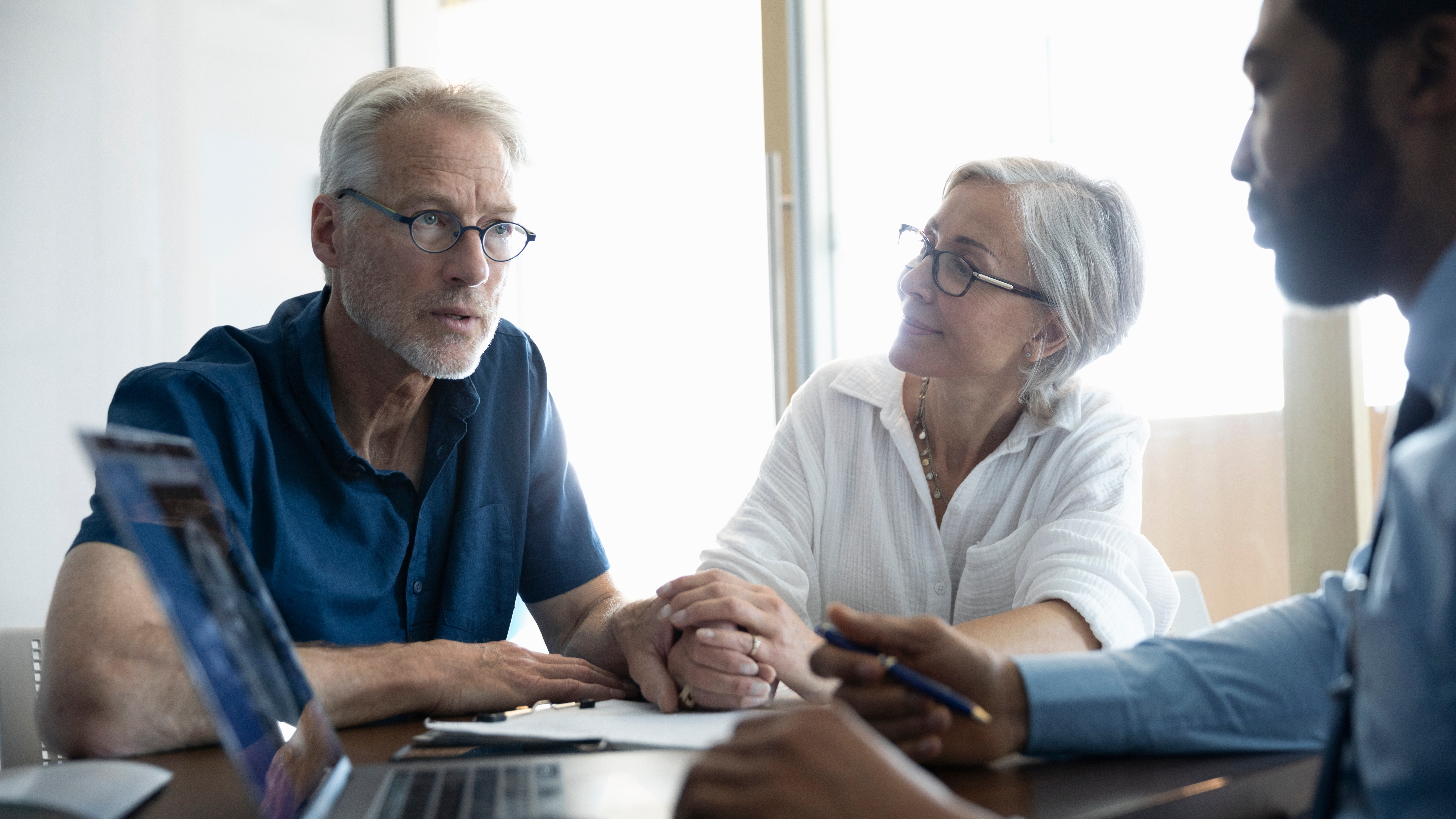 Consultant discussing insurance with senior couple