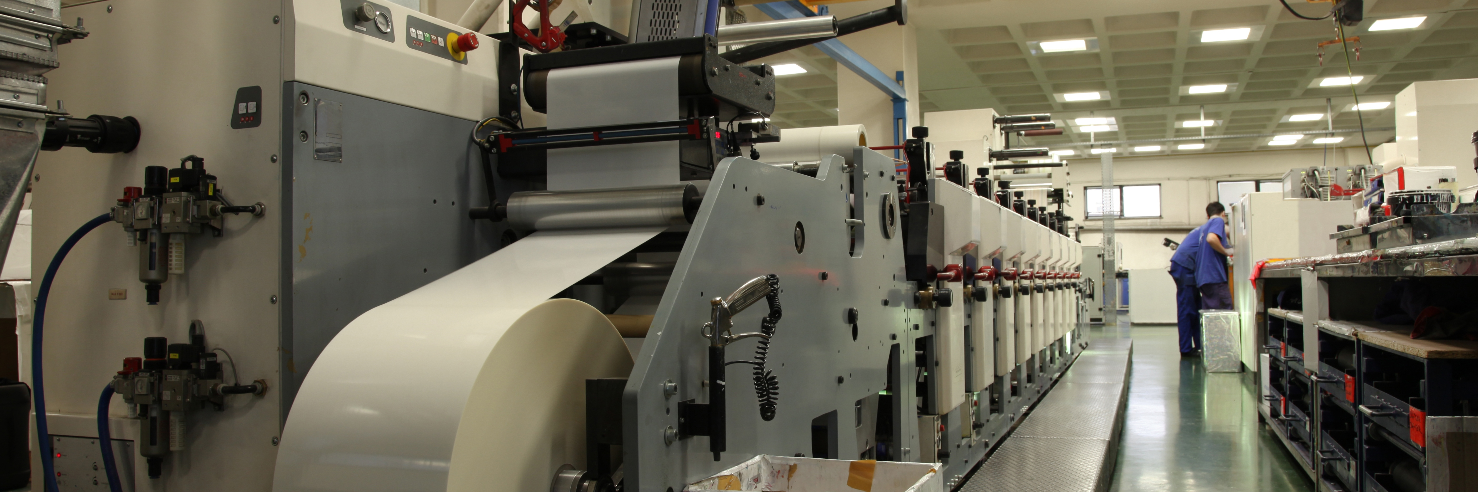 printing machine with roll of paper in factory