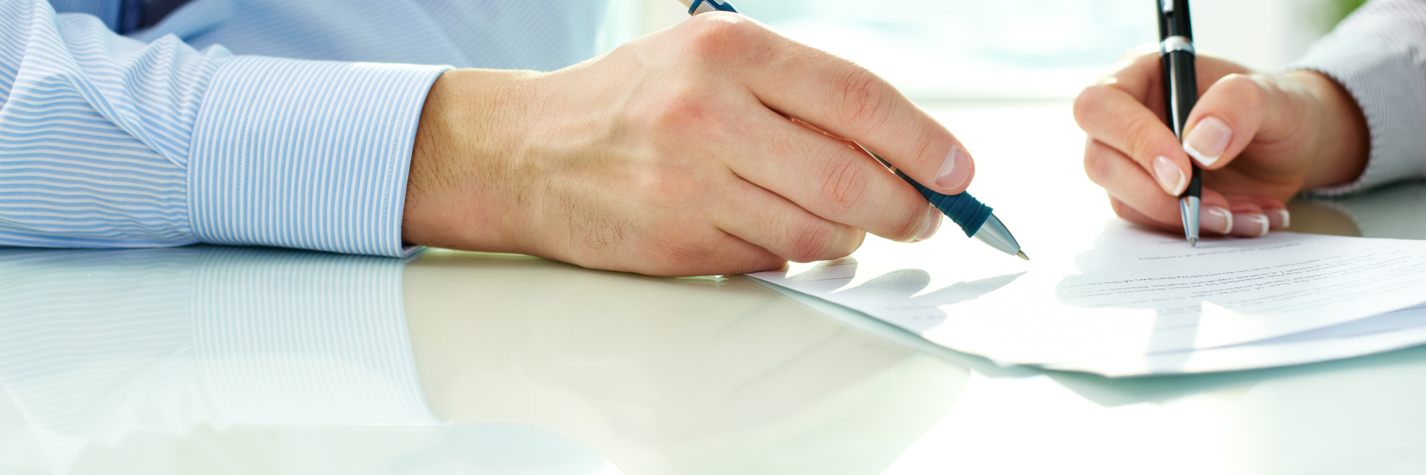 Business persons signing a document