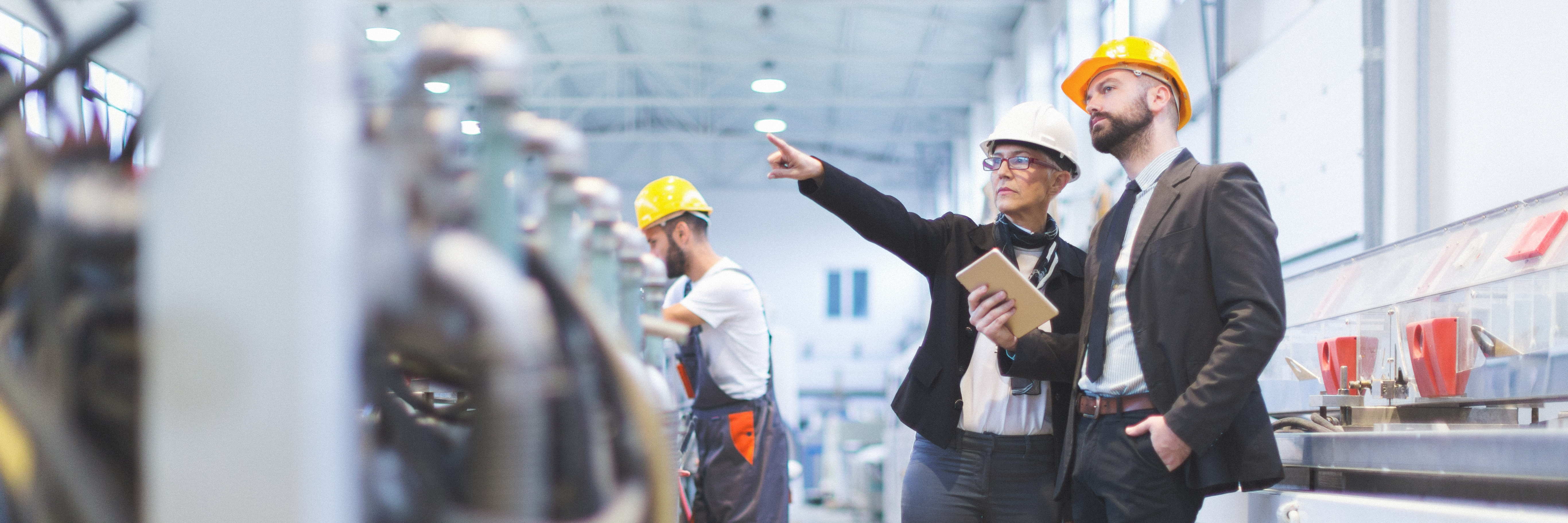 Careers - The Opportunities - Man and woman inspect industrial work place
