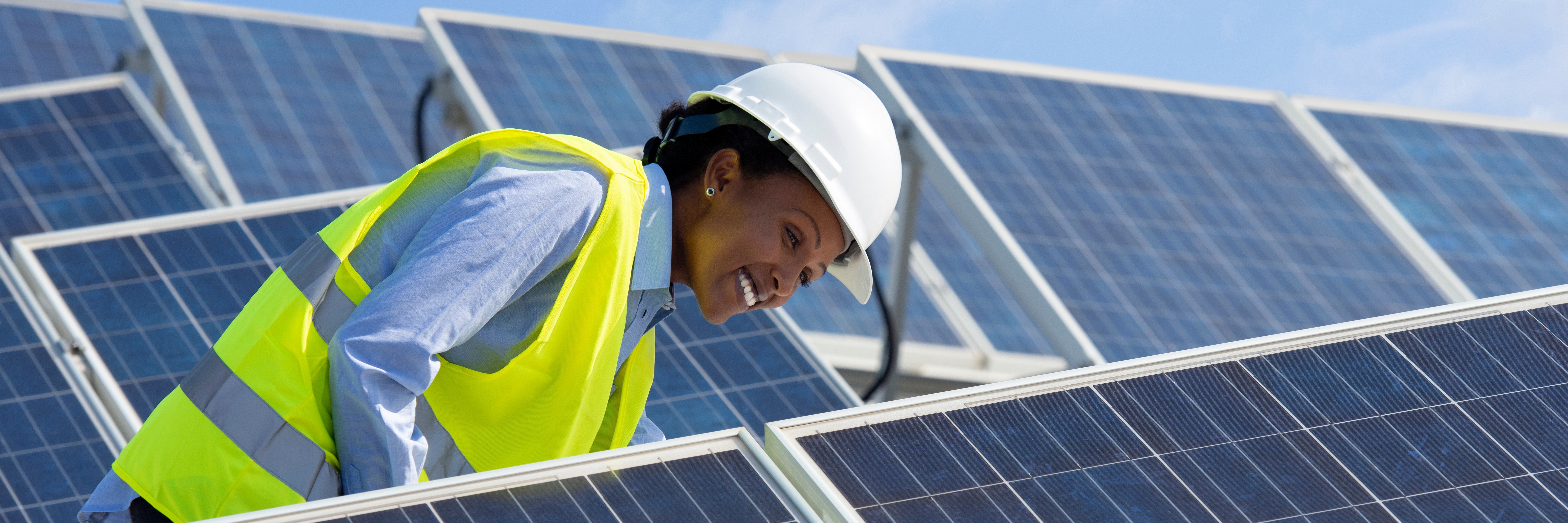 Female engineer with solar panels  - HSB Engineering Services