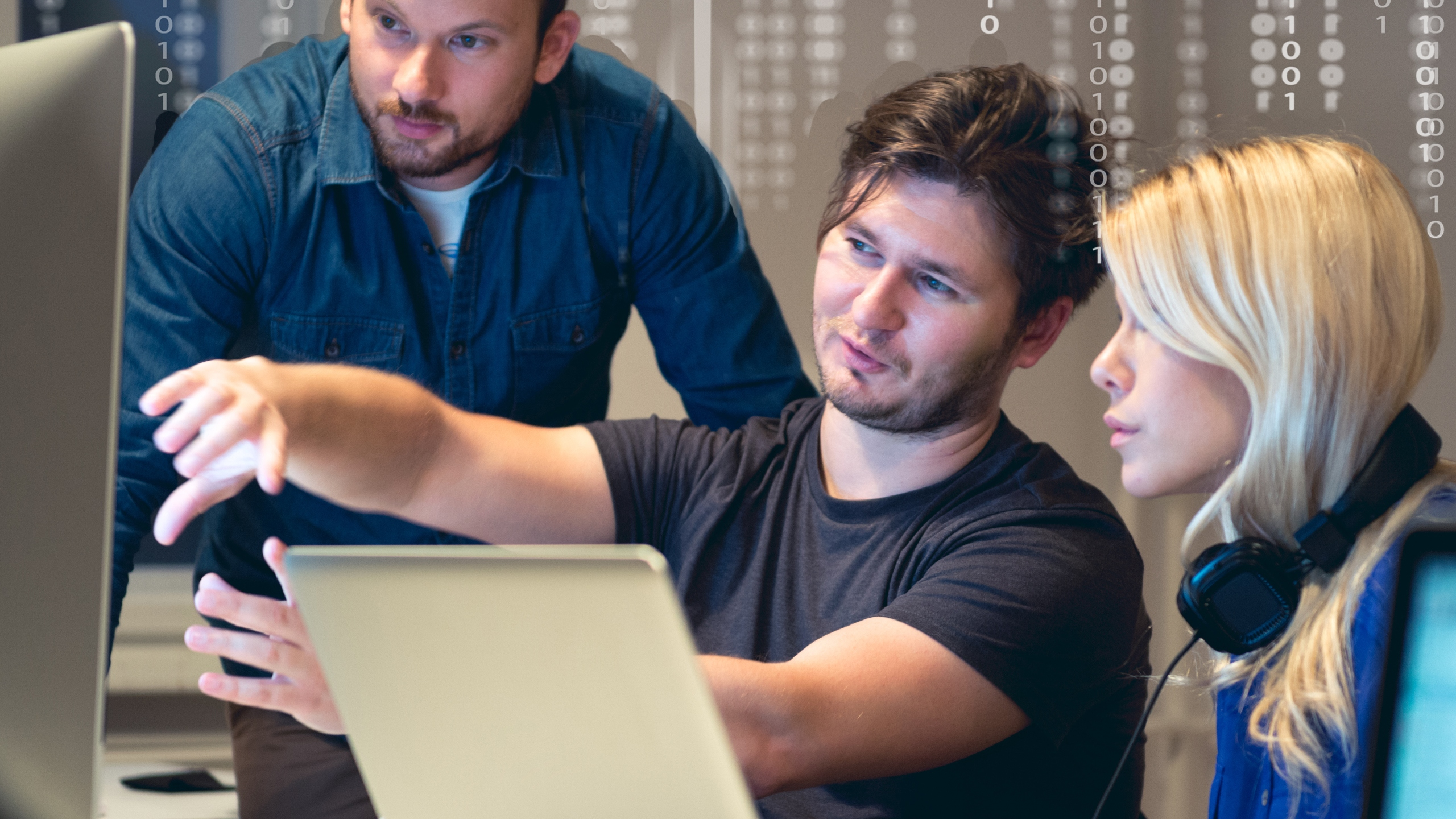 Three young professional group and living benefit experts discussing innovative solutions while analyzing data on one computer screen
