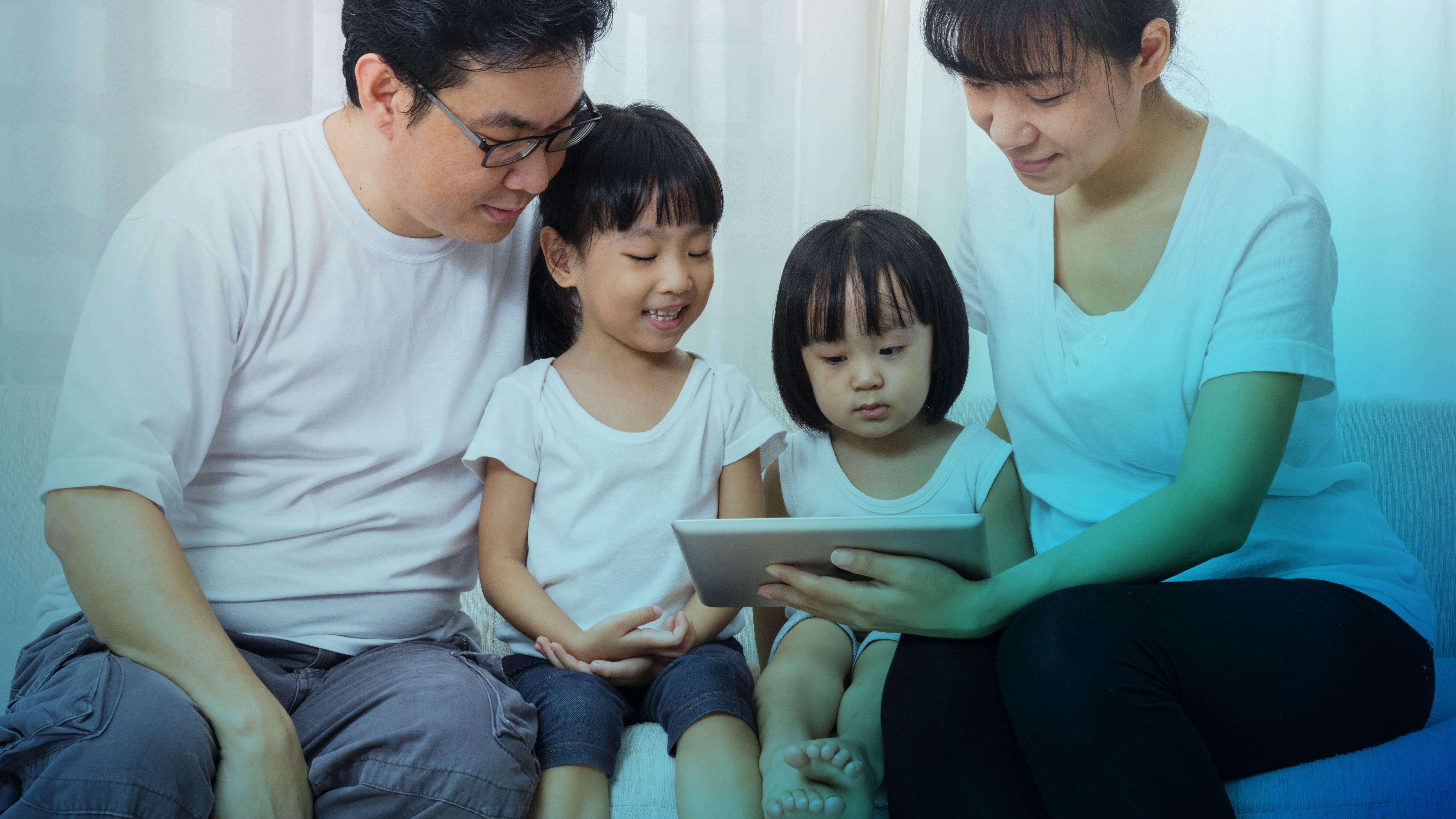 Family of four making a decision on ipad