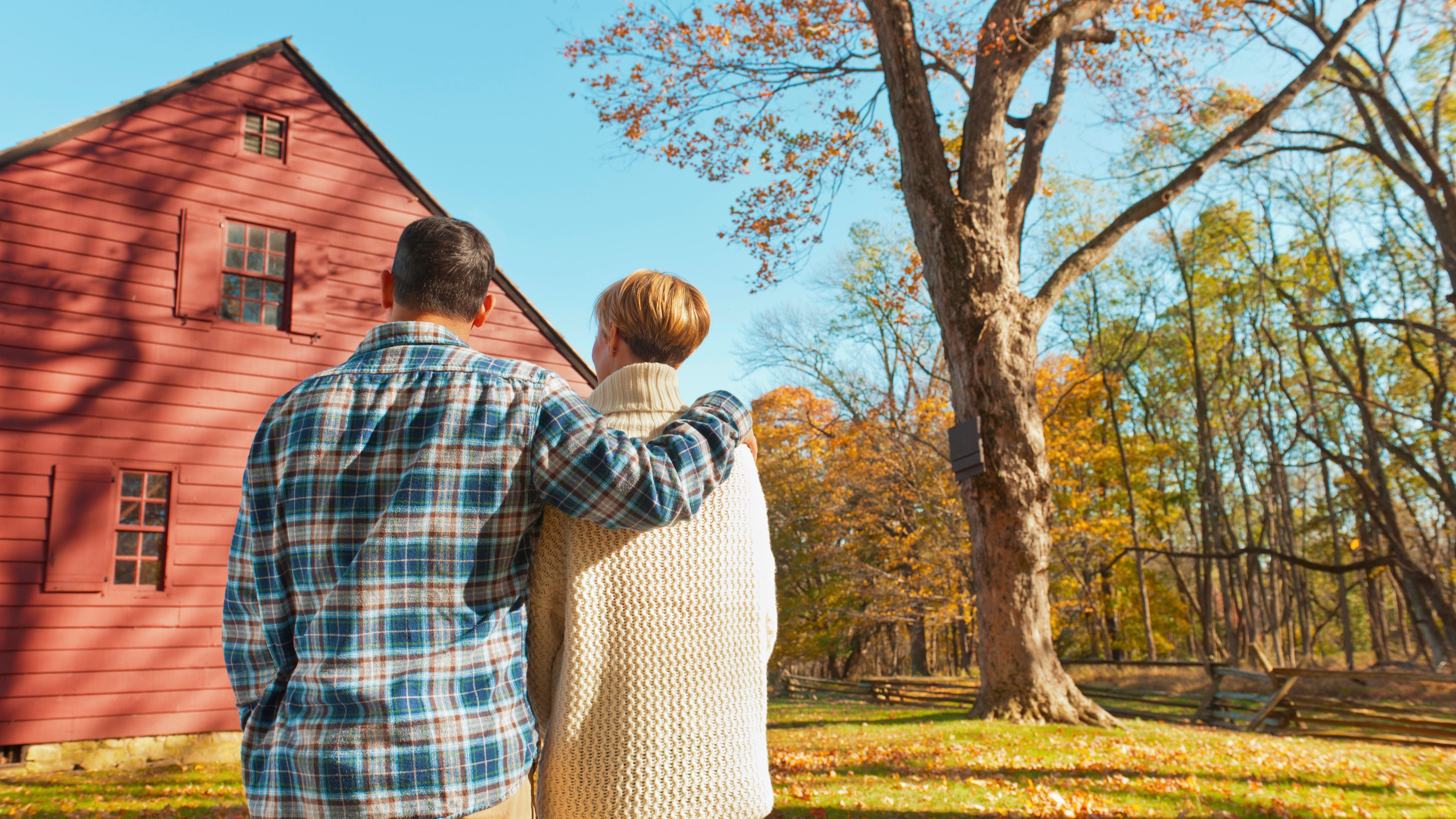A couple looking at a home on their property